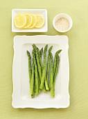 Steamed Asparagus on a Plate, Lemon Slices and Sea Salt