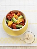 Bowl of Heirloom Tomato Wedges; Small Bowl of Sea Salt