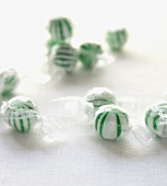 Green and White Hard Candies Wrapped in Plastic