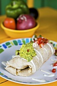 Burrito Topped with Guacamole and Salsa