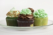 Four Assorted Cupcakes on a Glass Plate