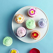 Pastel Cupcakes; Some with Flower Garnishes