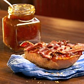 Crispy Bacon Strips and Marmalade on Toasted White Bread