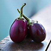 Small Group of Eggplants on Wooden Table
