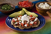Tostada with Beans, Tomato and Cheese; Fresh Avocado