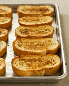 Slices of Garlic Bread on a Baking Sheet