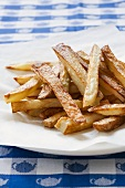 Oven Baked French Fries Piled on a Plate