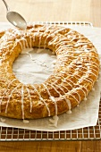 Icing a Pecan Holiday Kringle; Christmas Danish Ring