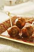 Hors d'oeuvre Sweet and Sour Meatballs with Toothpicks