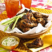 Barbecue Chicken Legs in Wooden Bowl; Blue Cheese Dip; Iced Tea