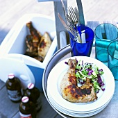 Grilled Chicken on Stacked Plates; In Cooler; Bottles of Beer