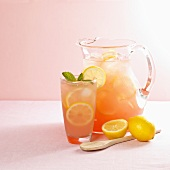 Pitcher and Glass of Pink Lemonade; Wooden Spoon; Lemons