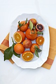 Oranges; Whole and Sliced on a Platter; From Above