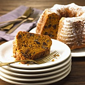 Piece of Pumpkin Nut Spice Cake on Stacked Plates