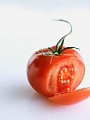 Vine Ripe Tomato Sliced Once; White Background