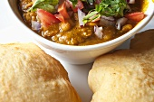 Bowl of Chole with Bhatura (Chickpea Curry with Fried Indian Bread)