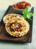 Sun Dried Tomato Quiches on Wooden Tray