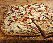 Smoked Salami Pizza on Cutting Board; Sliced