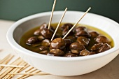 Bowl of Marinated Olives with Toothpicks