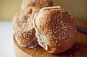 Whole Wheat Sesame Buns on Cutting Board
