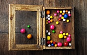 Colorful Gumballs in a Wooden Shadow Box
