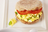 Breakfast Sandwich; Scrambled Eggs with Peppers and Tomato on English Muffin