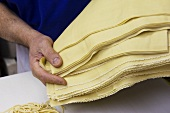 Man Holding Sheets of Fresh Pasta