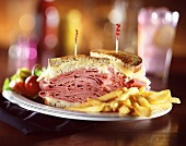 Reuben Sandwich Halved with French Fries