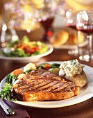 Grilled T-Bone Steak with Baked Potato and Veggies