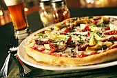 Sundried Tomato and Artichoke Pizza; Glass of Beer