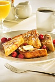 French Toast with Raspberries and Butter; Cup of Coffee