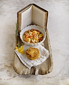 Bowl of Vegetable Soup with Potato Pancakes; Book; On Rustic Tray