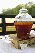 Sweet Iced Tea in a Jug; Jar Glass; On Outdoor Table