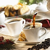 Coffee Pouring into Coffee Cup; Biscotti and Coffee Beans