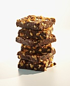 Chocolate Nut Brownies; Stacked on White Background