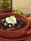 Bowl of Cuban Black Bean Soup with Dollop of Sour Cream