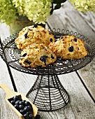 Blueberry and Orange Scones on Wire Stand; On Rustic Table