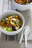 Bowls of Chickpea and Butternut Squash Curry; Two Spoons