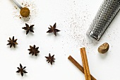 Star anise, cinnamon sticks and nutmeg with a grater