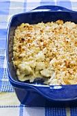 Cheesy Cauliflower Casserole in Baking Dish; Scoop Removed