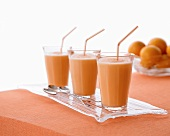 Three creamsicle smoothies (cantaloupe melon and orange juice)