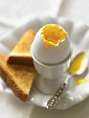 A soft boiled egg and toast triangles