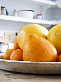 Assorted Citrus Fruit in a Dish on a Kitchen Counter