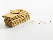 A stack of crispbreads, one with a bite taken out