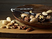Mixed Nuts; Whole and Cracked in a Wooden Bowl with Crackers