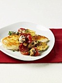 Chicken breast with artichokes, dried tomatoes and mushrooms
