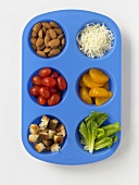 Assorted Ingredients Divided in a Blue Silicone Tray