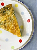 Slice of Spinach Frittata on a Polk-a-Dot Plate