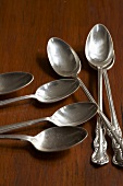 Silver Spoons on Wood Surface