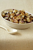 Serving Bowl of Sauteed Potatoes and Onions; Serving Spoon